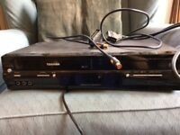 DVD and VHS Toshiba video player with all leads, instructions and remote control