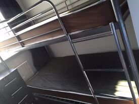 Nearly new bunk beds with waterproof mattresses