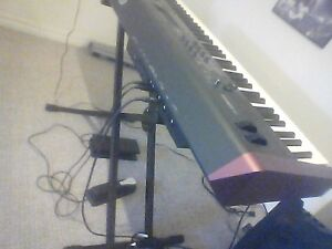 Yamaha MOXF8 keyboard and Roland KC 150 amp