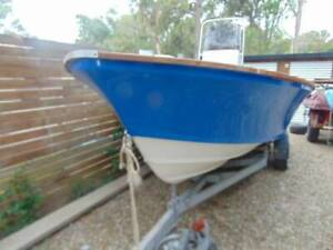 centre consol 16 ft boat motor and trailer