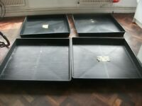 Set of four large garden trays by Garlands . Made of plastic . Size :1.2m by 1.2m and 12cm high