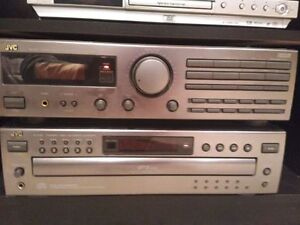 JVC 5-disc changer and tuner with 250W tower speakers.