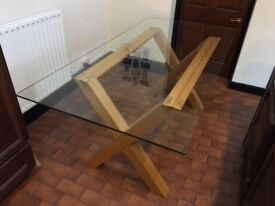 Oak dining table with glass top