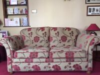 A 2 seater sofa bed & 2 seater sofa, both covered in same fabric. Immaculate condition. Cream/Red