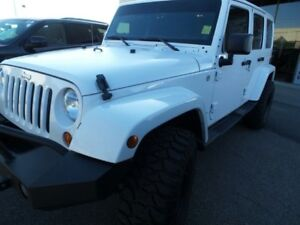 Lifted 2013 Jeep Wrangler Unlimited Sahara w/ Snow Tires