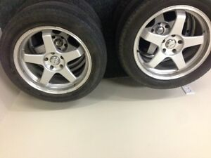 "19"" rims with rubber Michelin latitude m+s  Touring."