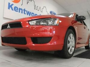2015 Mitsubishi Lancer DE 5-SPD manual. Kick back in style with