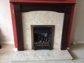 Gas fire with Mahogany surround, back panel and hearth.