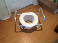 Raised toilet seat with support handles