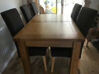 Canterbury oak veneer extending dining table and 6 chairs