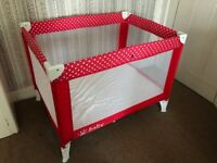 Travel cot with additional mattress