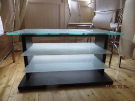 Glass and dark wood TV stand