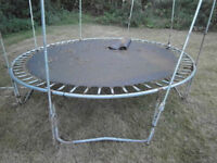 Junior trampoline about 12 feet across, 3 feet off the ground with ladders REDUCED TO SELL