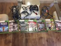 Pre-owned Xbox 360 core, 2 controllers, 7 games including Fifa 17, Grand Theft Auto V & Call Of Duty