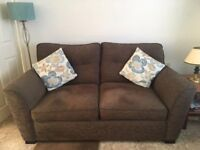 2-3 seater sofa with matching armchair. Only 2 years old, with little use