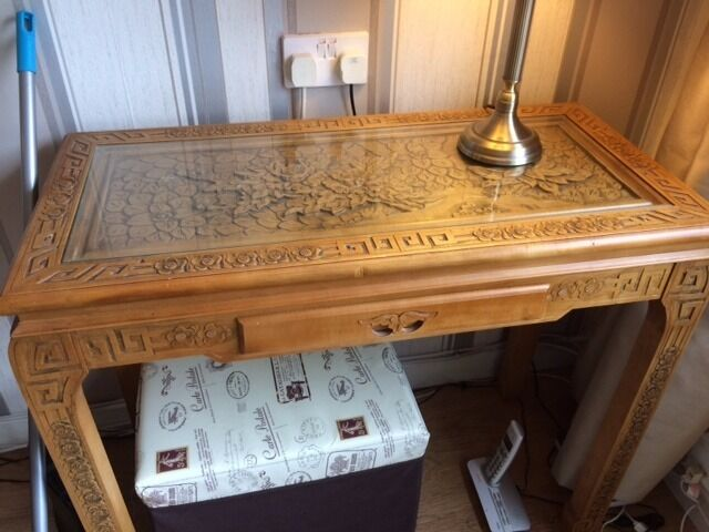 Console Table with oriental designin Summerston, GlasgowGumtree - Console table with oriental design and glass top with front drawer and legs carved in oriental design in great condition
