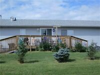 Mobile home on owned land for sale in Carstairs