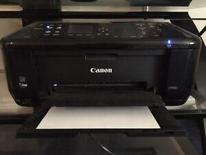 Canon PIXMA MX522 Wireless Color Photo Printer with Scanner.