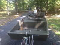 14 foot jon boat with 15 hp motor and trailer
