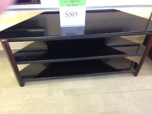 GLASS TV STAND $100.00 + TAXES