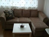 LEFT OR RIGHT HAND FACING BEIGE CORNER SOFA WITH CUSHIONS AND COFFEE TABLE