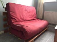 Small double futon from smoke free, pet free home. Pine frame