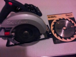 Skil corded circular saw 10 amp 7-7.25 with new spare blade