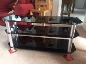 TV STAND with three smoked glass shelves. As new condition.