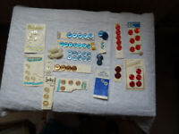 Various red, blue, beige and white buttons in matching sets