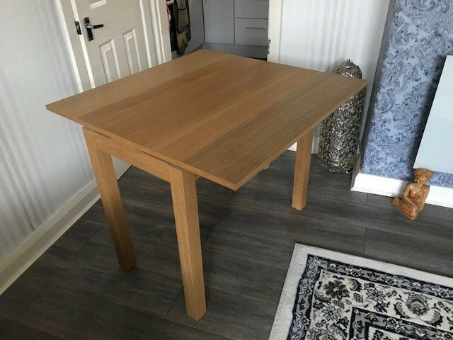 small Ikea extending dining table, ideal for small spaces, sits four comfortably when extended.