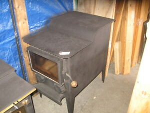 Two good wood stoves    woodstove