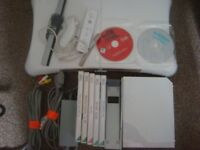 nintendo wii with games and board for sale or swap