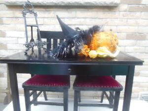 black wood table with chairs, oriental pictures, bakers rack