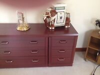 Low height bedroom furniture in a rich cherry tone wood