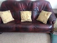 3 piece suite excellent condition real leather and solid wood frame. Burgundy/brown