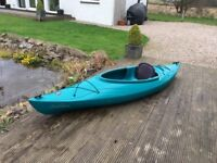 Single Kayak with paddle and spray deck