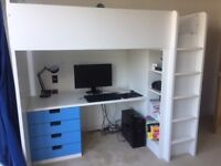 Loft bed with desk, drawers, shelves and wardrobe