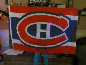 Montreal Canadiens flags and Stanley Cup banner