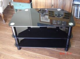 """BLACK GLASS TV STAND (IN ALMOST NEW CONDITION) 31 1/2""""X17 3/4""""X19"""""""