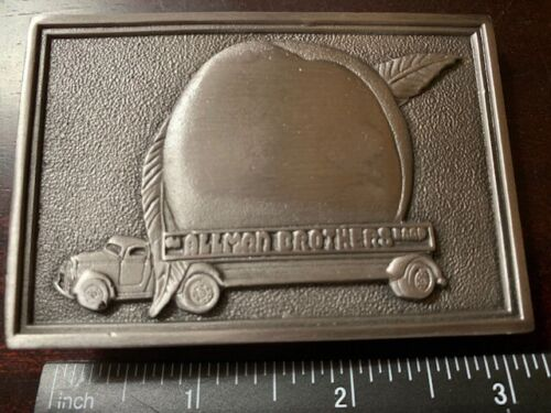 The ALLMAN BROTHERS Band Belt Buckle Peach Solid Metal 3 inches wide