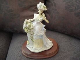 Constance Figurine on wooden base