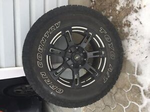 4 Toyo Open Country A/T with black DT Bullet Rims