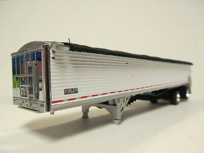 DCP 1/64 SCALE 50' WILSON BELT TRAILER  WHITE (CUSTOM MADE INTO SPREAD AXLE)