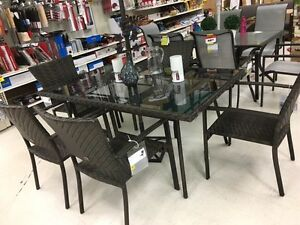 6 outdoor wicker chairs and glass table