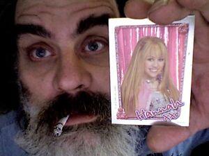 An-ultra-rare-print-of-me-holding-an-ultra-rare-Hannah-Montana-trading-card
