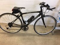 Giant carbon frame roadbike with flat handle bars