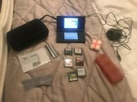 Nintendo DS with charger case and 6 games