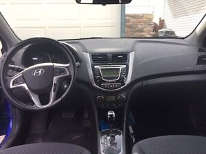 2013 Hyundai Accent GLS Power sunroof, heated seats.
