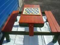 GARDEN/INDOOR CHILDS SEATING, WITH SNAKES & LADDERS BOARD ON TABLE,