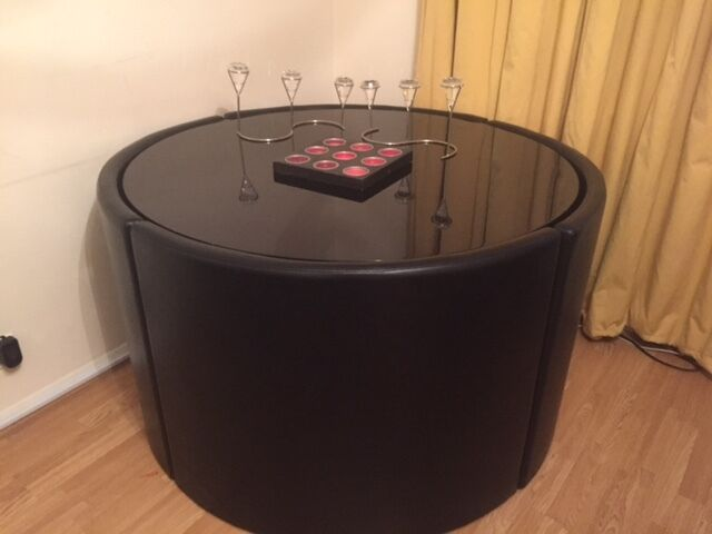 Round Hideaway Black Next Dining Table And Leather Chairs